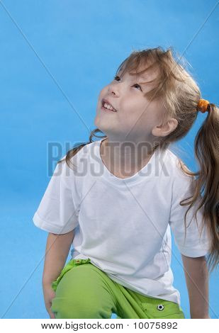 The Little Girl Is Looking Upwards On Blue