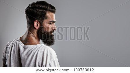 Portrait of a tattooed bearded guy