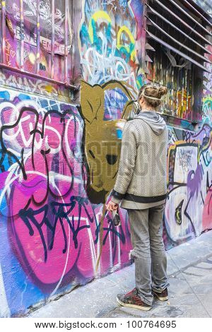 An Artist Painting In Laneway