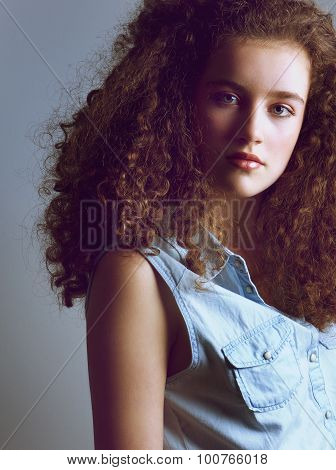 Portrait Of A Beautiful Young Fashion Model In Denim Shirt