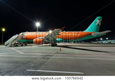 KIEV, UKRAINE - JULY 10, 2015: Night preflight preparation aircraft airline Windrose at Borispol Int