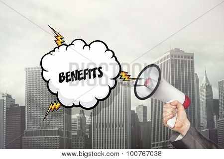 Benefits text on speech bubble and businessman hand holding megaphone