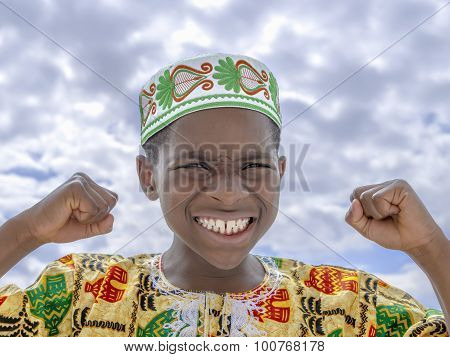 Afro boy roaring, fists clenched