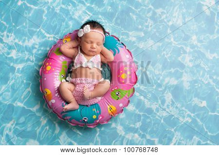 Sleeping Newborn Baby Girl Wearing A Bikini