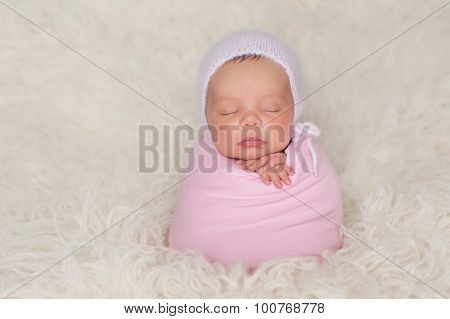 Newborn Baby Girl With Pink Bonnet And Swaddle