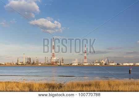 Refinery And River In Evening Sunlight