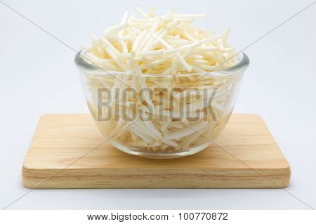 Cup of bean spouts on wooden board. white background