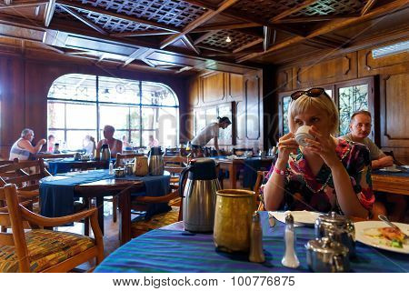 HURGHADA EGYPT - MAY 18 2015: peole having breakfast in restaurant in Arabia Asur Resort on May 18, 2015 in Hurghada, Egypt