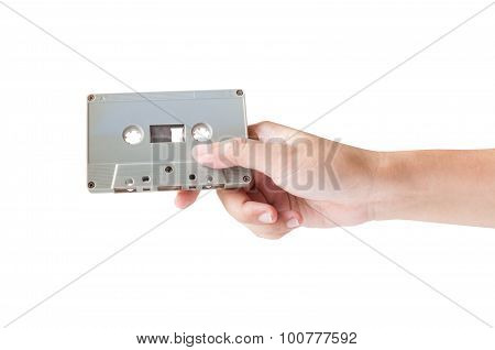 Hand Holding Cassette Tape Isolated