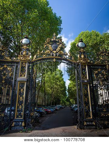 Ornate gate leads to Monceau Park in Paris, France