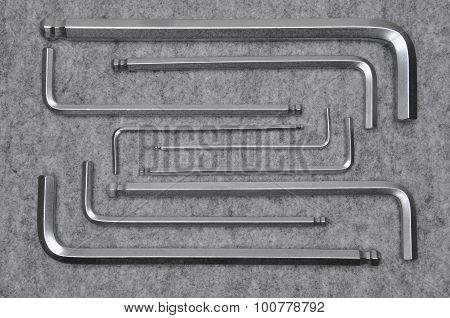 Allen keys on grey felt background