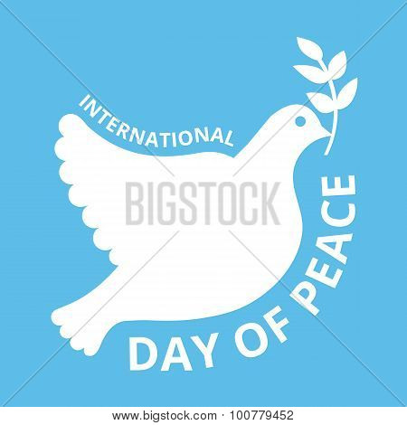 International day of peace logo concept. Beautiful pigeon with branch