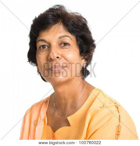 Portrait of a 50s Indian mature woman smiling, isolated on white background.