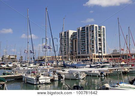 Sailing Yachts And Modern Buildings In Herzliya Marina, Israel.