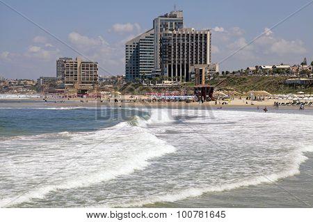 Sand Beach Of The Mediterranean Sea And Modern Hotels In Herzliya, Israel.