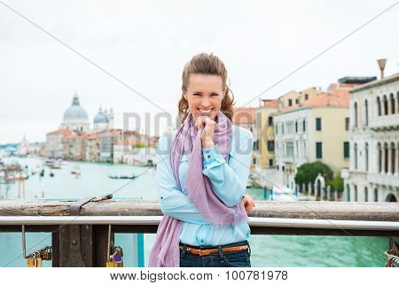 Giggling Woman Tourist On Bridge With Arms Crossed
