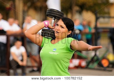 Orel, Russia, September 5, 2015: Woman Powerlifter Lifts Heavy Dumbell With One Hand In Competition