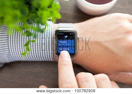 Man Hand With Apple Watch And App Twitter On Screen