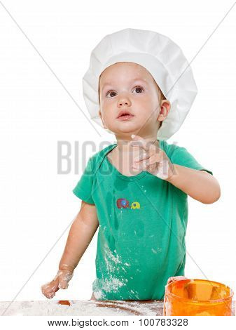 Cute Kid In A Chef's Hat Preparing The Pizza