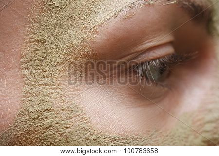Beautiful Young Woman With Clay Facial Mask