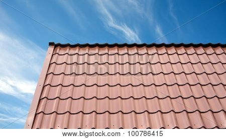 Roof of a country house covered with brown tile