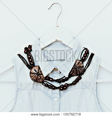 Wooden Jewelry And Denim Clothing. Fashion Combination. Country Style