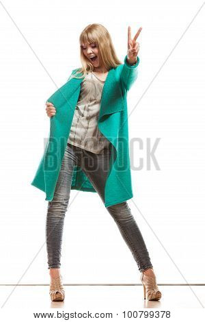 Woman Green Coat Showing Victory Sign