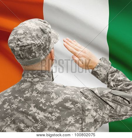 Soldier In Hat Facing National Flag Series - Ivory Coast