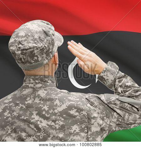 Soldier In Hat Facing National Flag Series - Libya