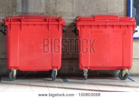 Red waste containers aka Litter bin garbage bin trash bin or waste bin