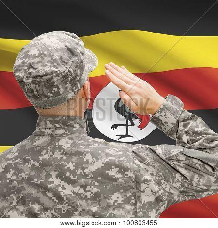 Soldier In Hat Facing National Flag Series - Uganda