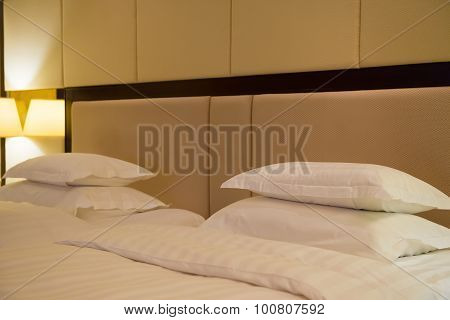 Side View Of Two Beds In A Hotel Room