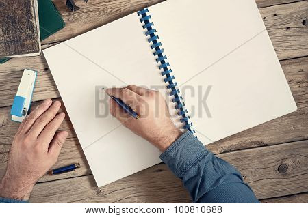 The Men Writes In An Open Notebook With Blank Pages On Wooden Desk Closeup
