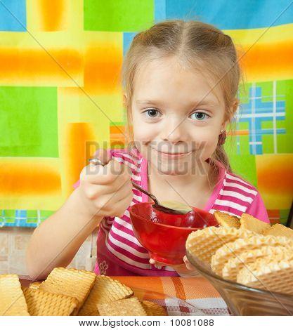 Little Girl Eating   Milk Desser