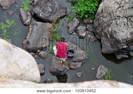 Poor Man Fishing In The River
