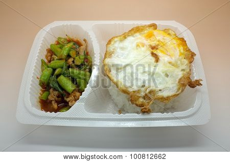Thai food box, Fried egg over rice with stir fried chicken and vegetable