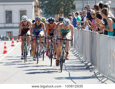Triathlete Gillian Backhouse Cycling, Followed By Competitors