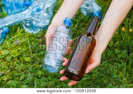 Plastic And Glass Bottle In Hand Of Woman, Littering Of Environment