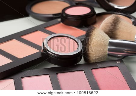 makeup cosmetics. compact powder, mineral foundation and makeup brushes