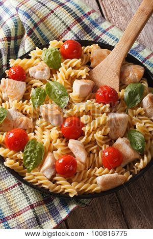 Italian Cuisine: Pasta Fusilli With Chicken, Cherry Tomatoes And Basil