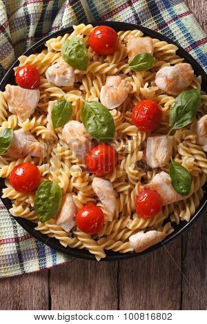 Fusilli Pasta With Chicken, Tomatoes And Basil Close-up. Vertical Top View