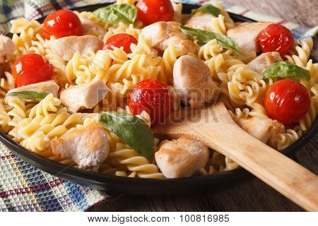 Italian Pasta Fusilli With Chicken And Tomatoes Macro On A Plate. Horizontal