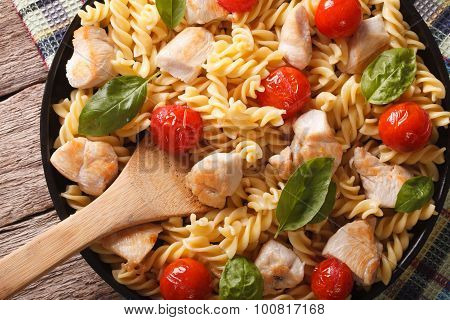 Fusilli Pasta With Chicken And Tomatoes Closeup. Horizontal Top View