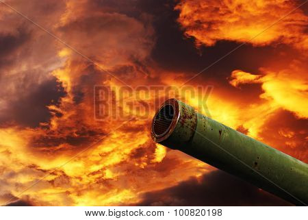 Cannon Under Cloudy Red Sky