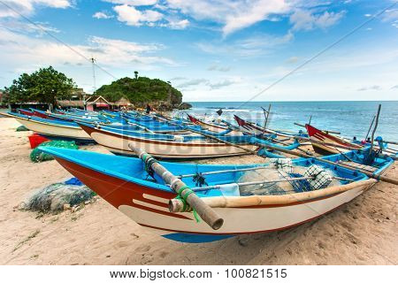 Traditional fishing boats on Drini beach on Java, Indonesia