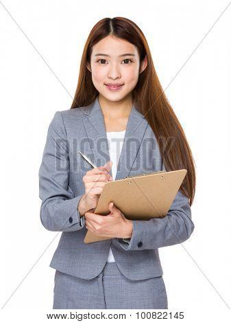 Businesswoman take note on clipboard