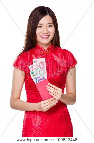 Chinese woman hold with red pocket with RMB