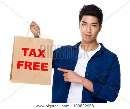 Asian mixed Indian man finger point to shopping bag for showing phrase of tax free