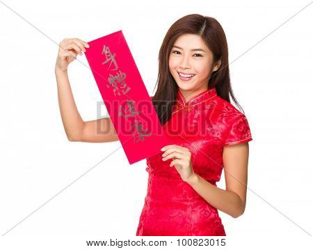 Young chinese girl show with calligraphy phrase meaning is blessing for good health