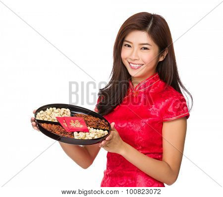 Young chinese girl hold with snack tray